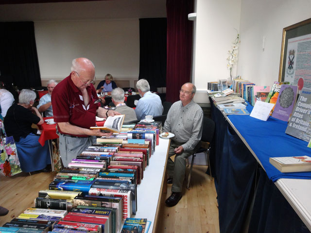 Tom is relaxed behind our bookstall, sitting with his tea and cakes while Ian rummages for a bargain
