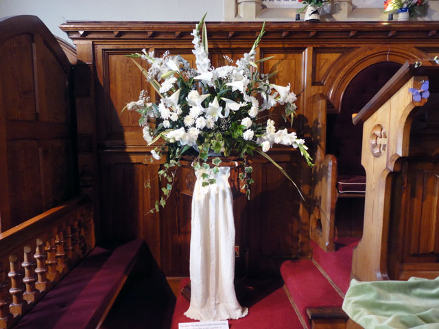 pew flower arrangements wedding