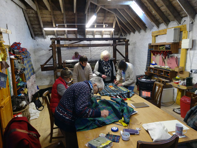 A view of the kilt-making studio today. Everyone is hard at work and the loom is being re-warped at the same time (by the end of the day some beautiful ...